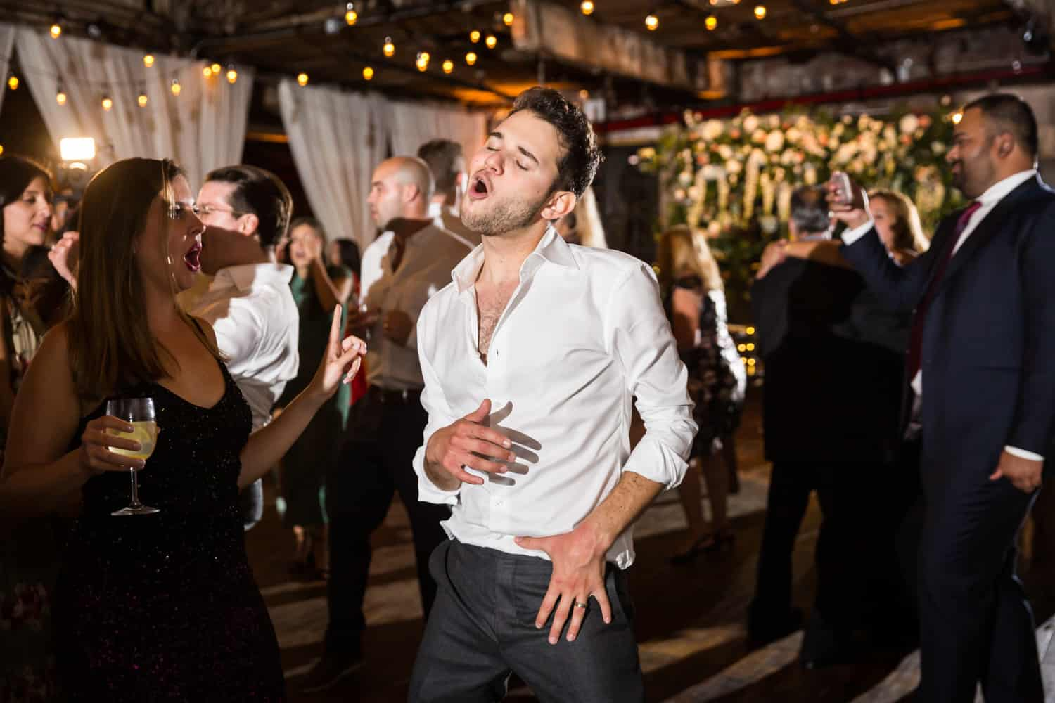 Greenpoint Loft wedding photos of groom dancing with guests
