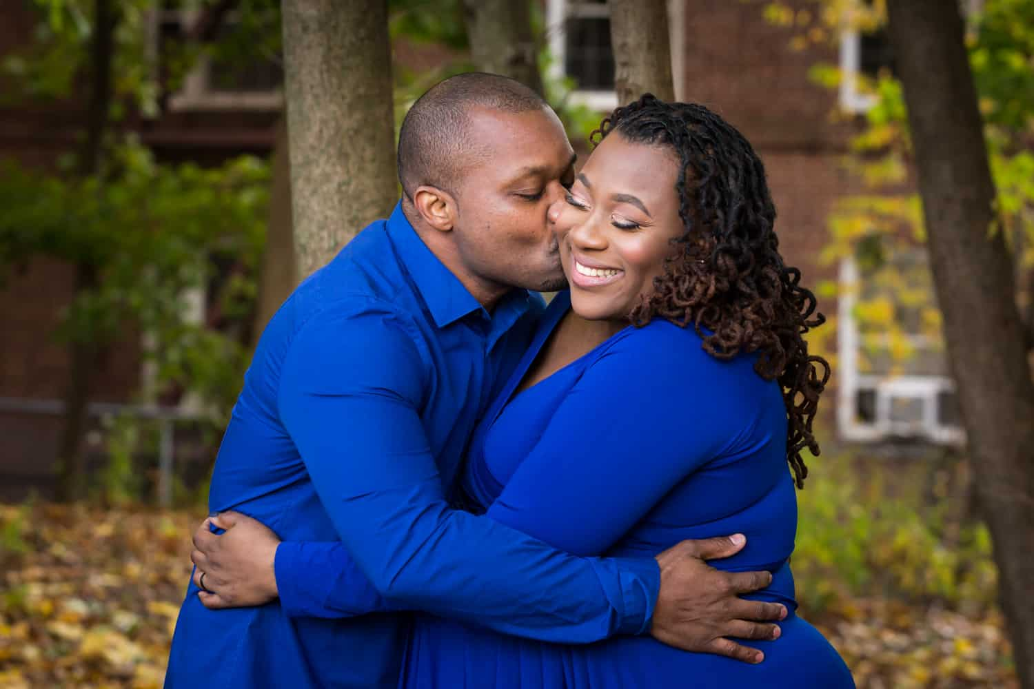 African American expecting couple hugging for an article on maternity photo shoot ideas
