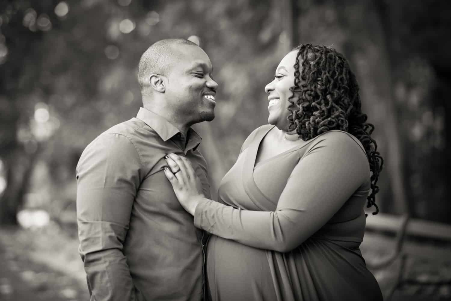 Black and white photo of African American couple laughing in Forest Park