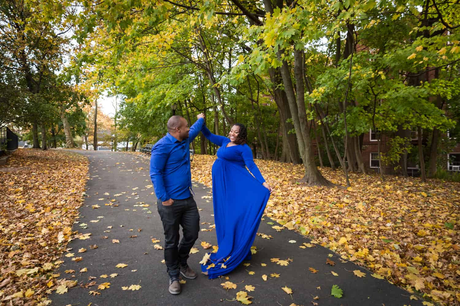 African American couple dancing in Forest Park for an article on maternity photo shoot ideas