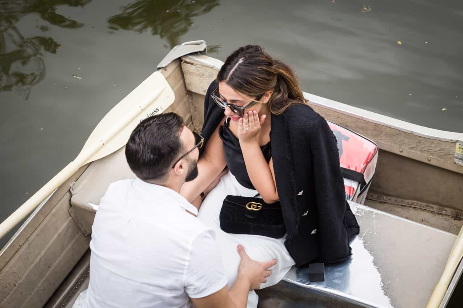 Overhead shot of man and woman in boat at a surprise proposal on Central Park Lake