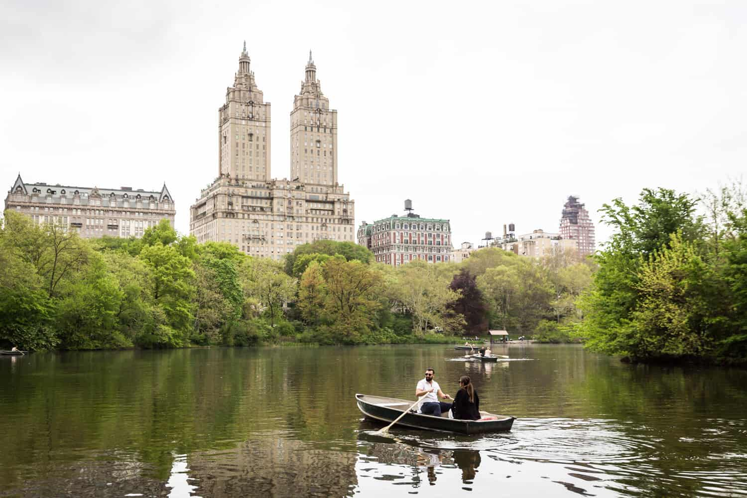 Couple in boat at a surprise proposal on Central Park Lake