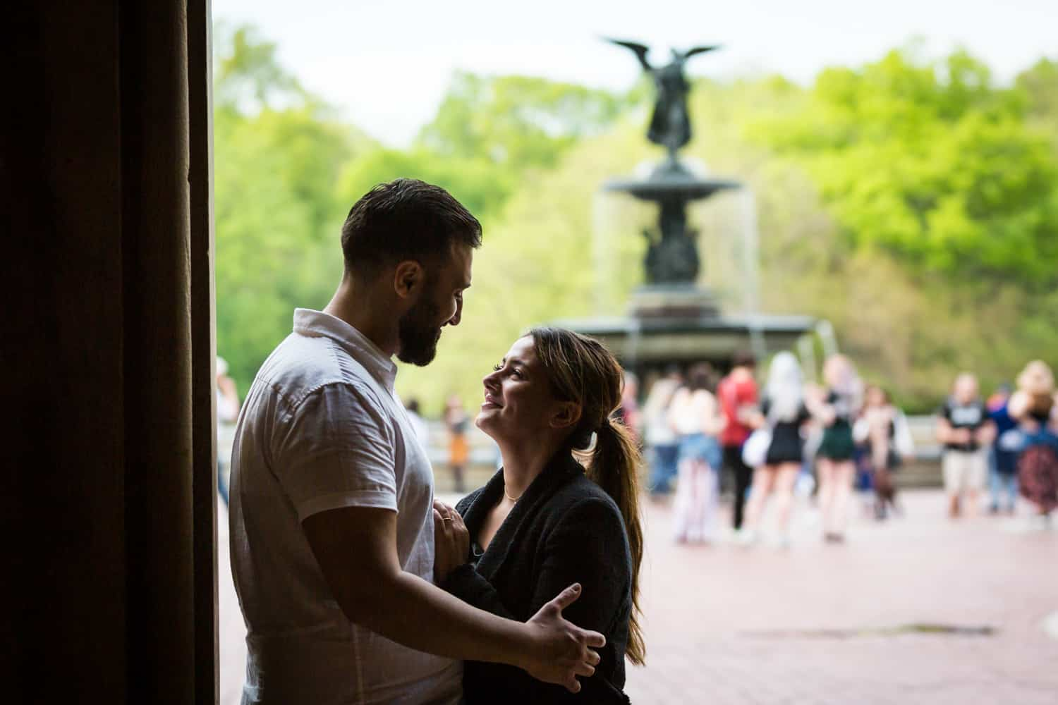Couple standing in archway leading to Bethesda Fountain