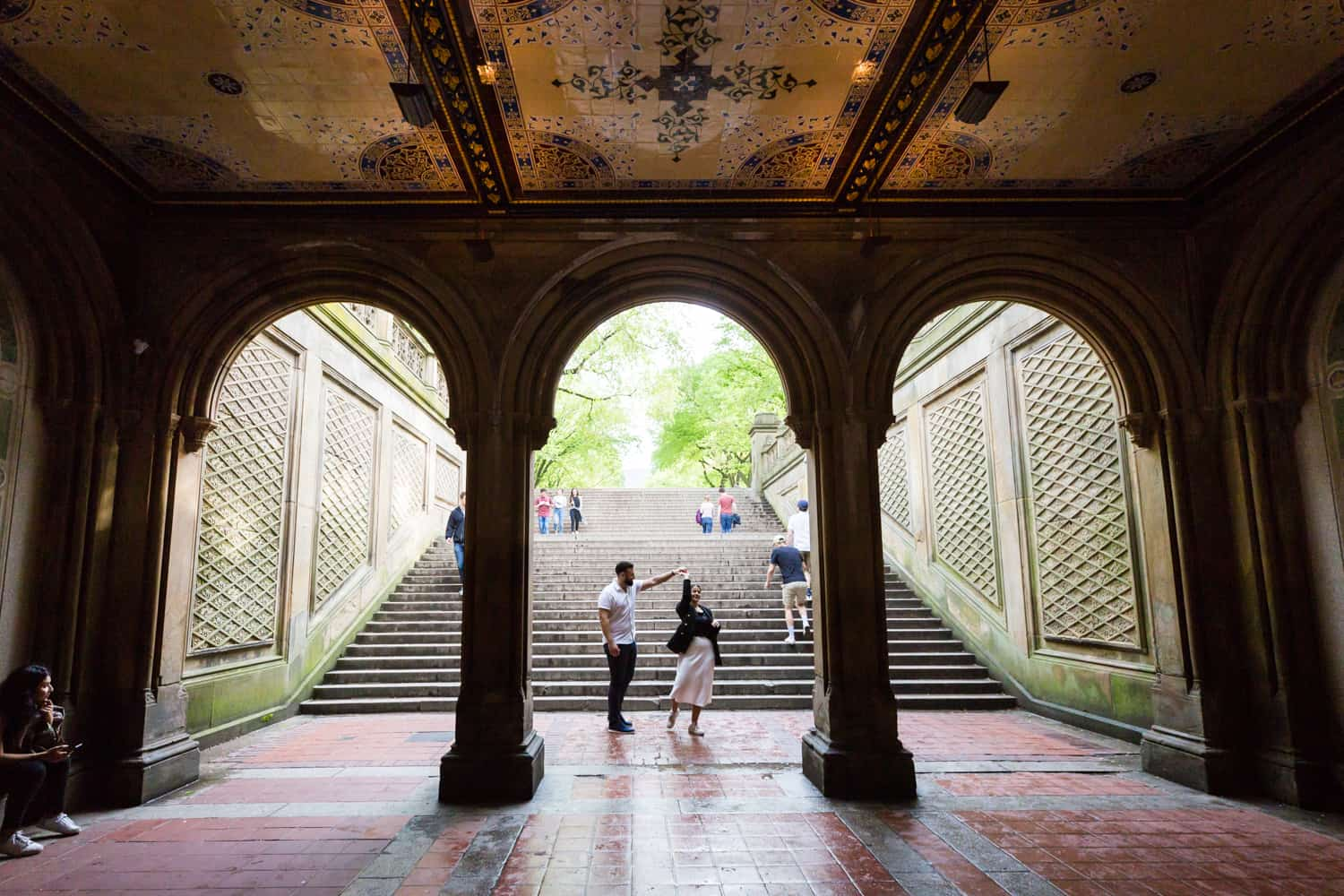 Couple dancing in Bethesda Terrace in Central Park