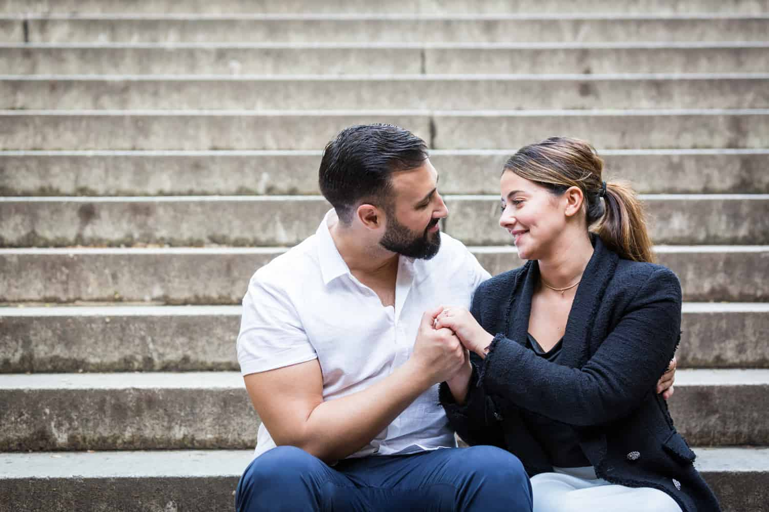 Couple sitting on stairs of Bethesda Terrace in Central Park