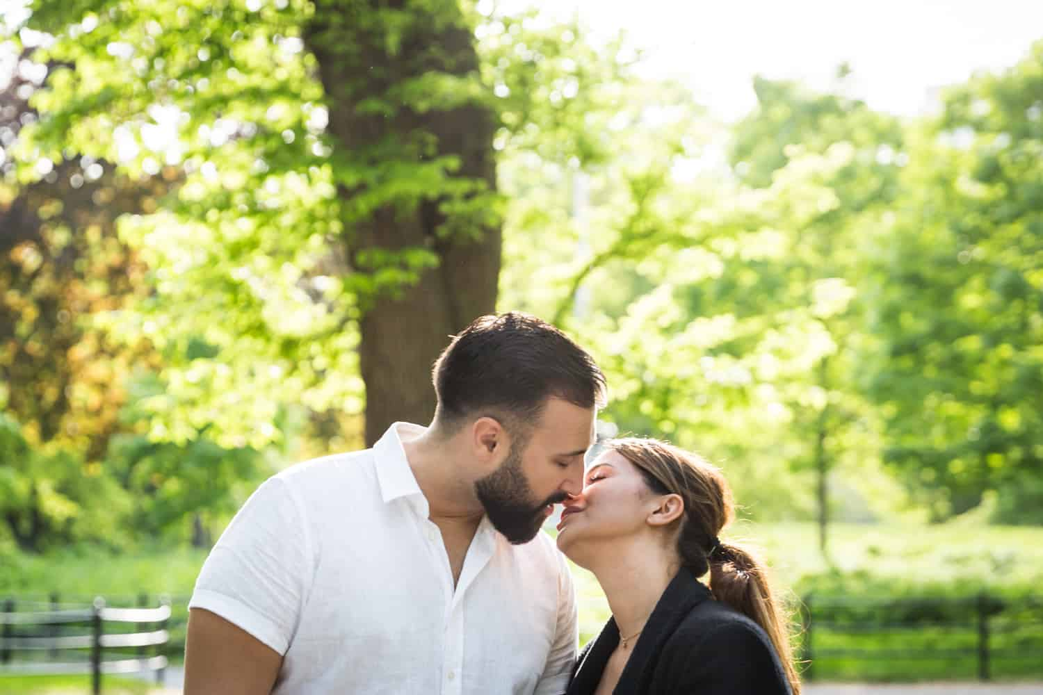 Couple about to kiss in Central Park