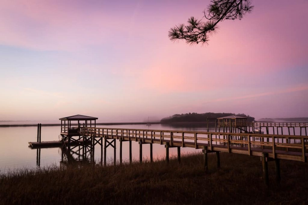 Dock on waterfront in Bluffton, South Carolina at sunrise