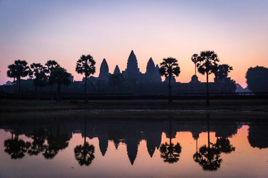 Angkor Wat reflected in water at sunrise