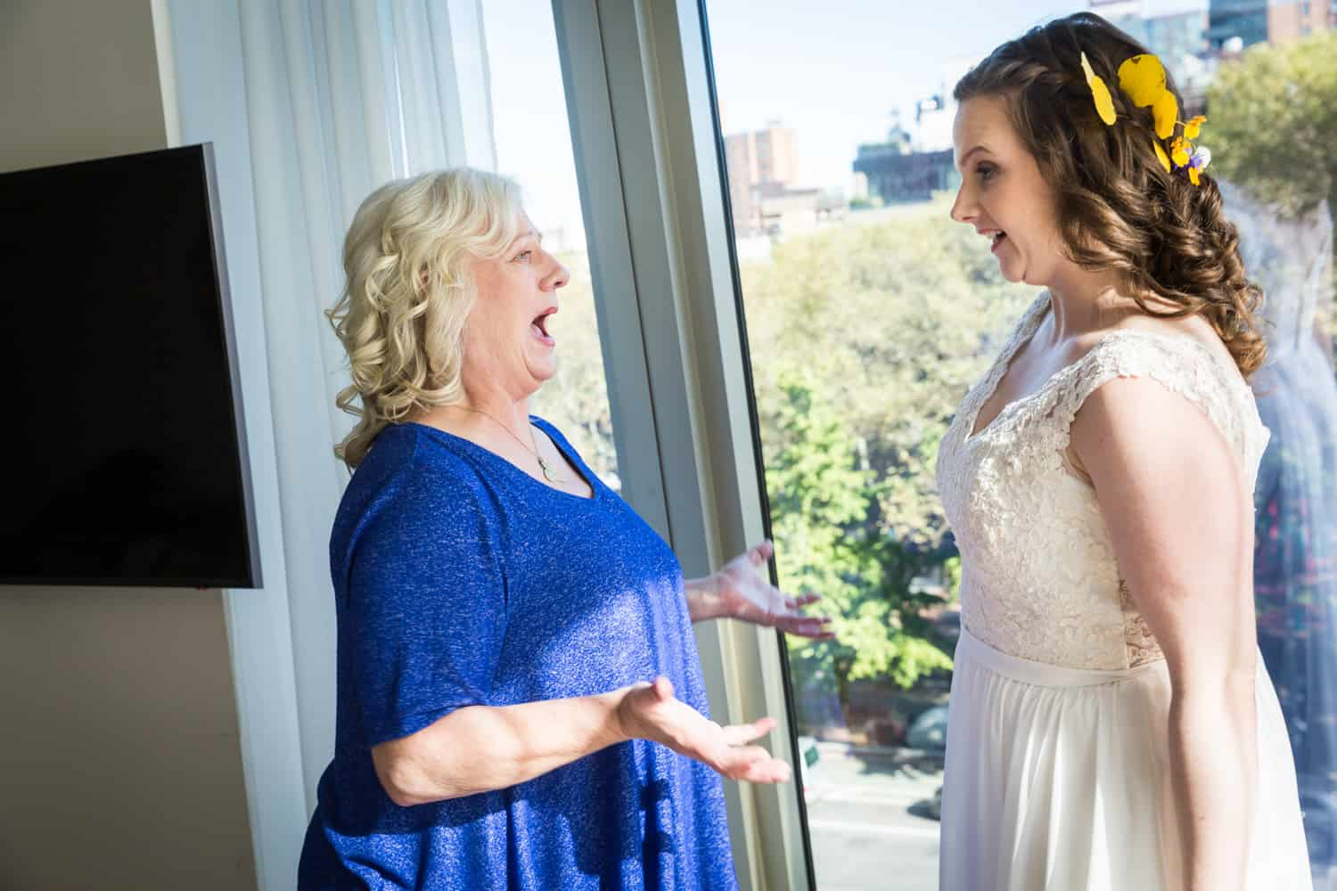 Mother of the bride seeing bride in wedding dress for the first time