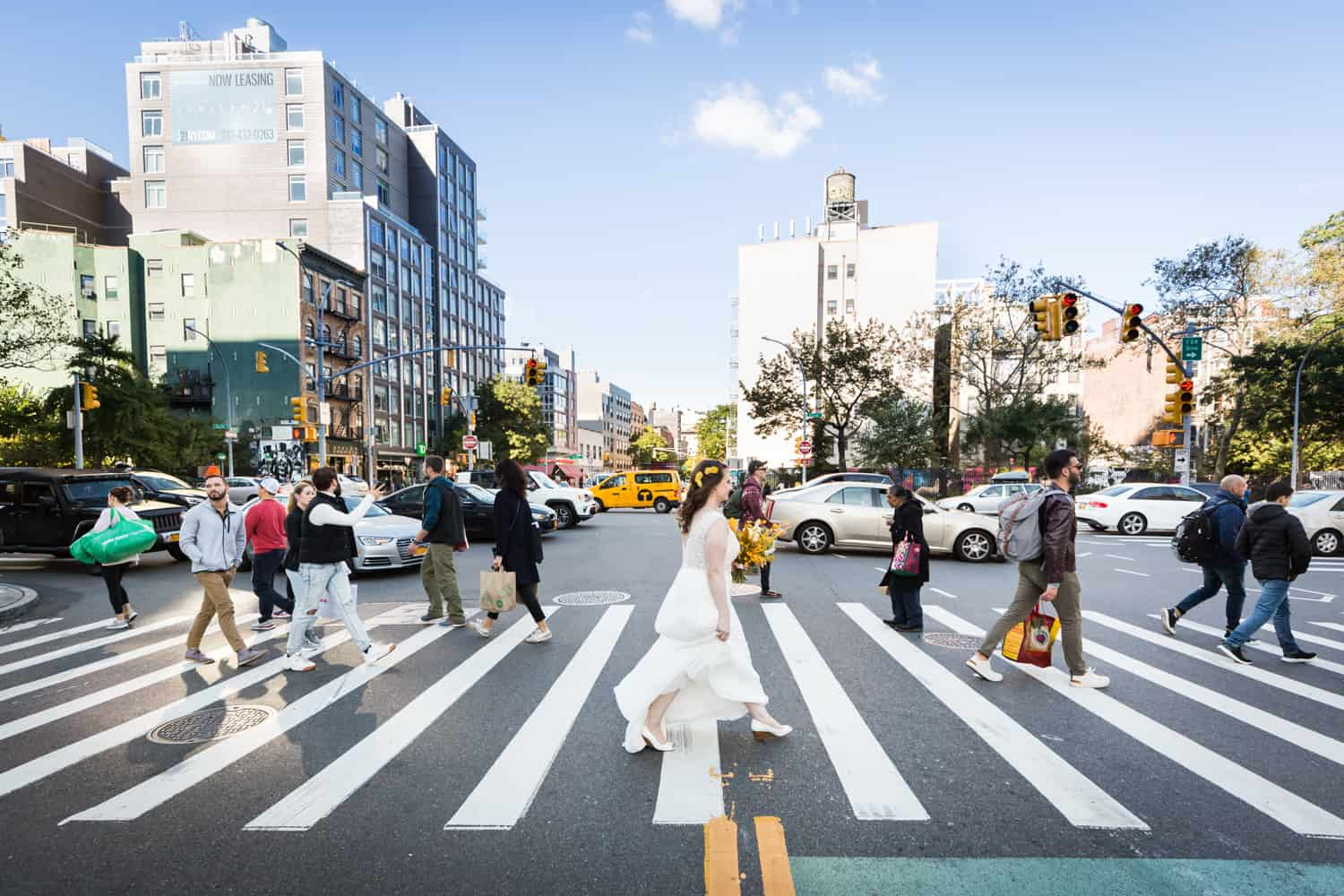Bride crossing NYC street in crosswalk