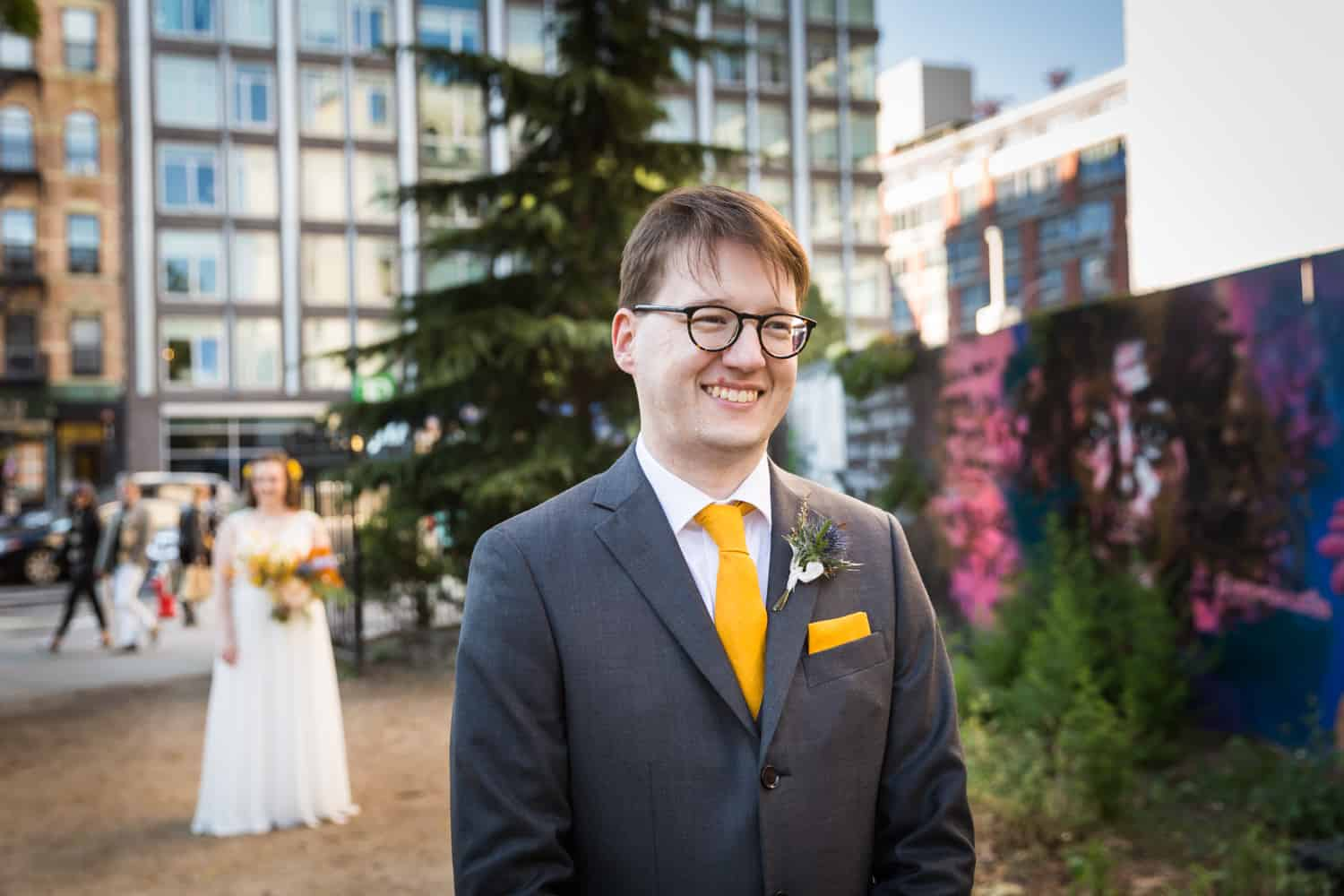 Groom waiting for first look to begin with bride