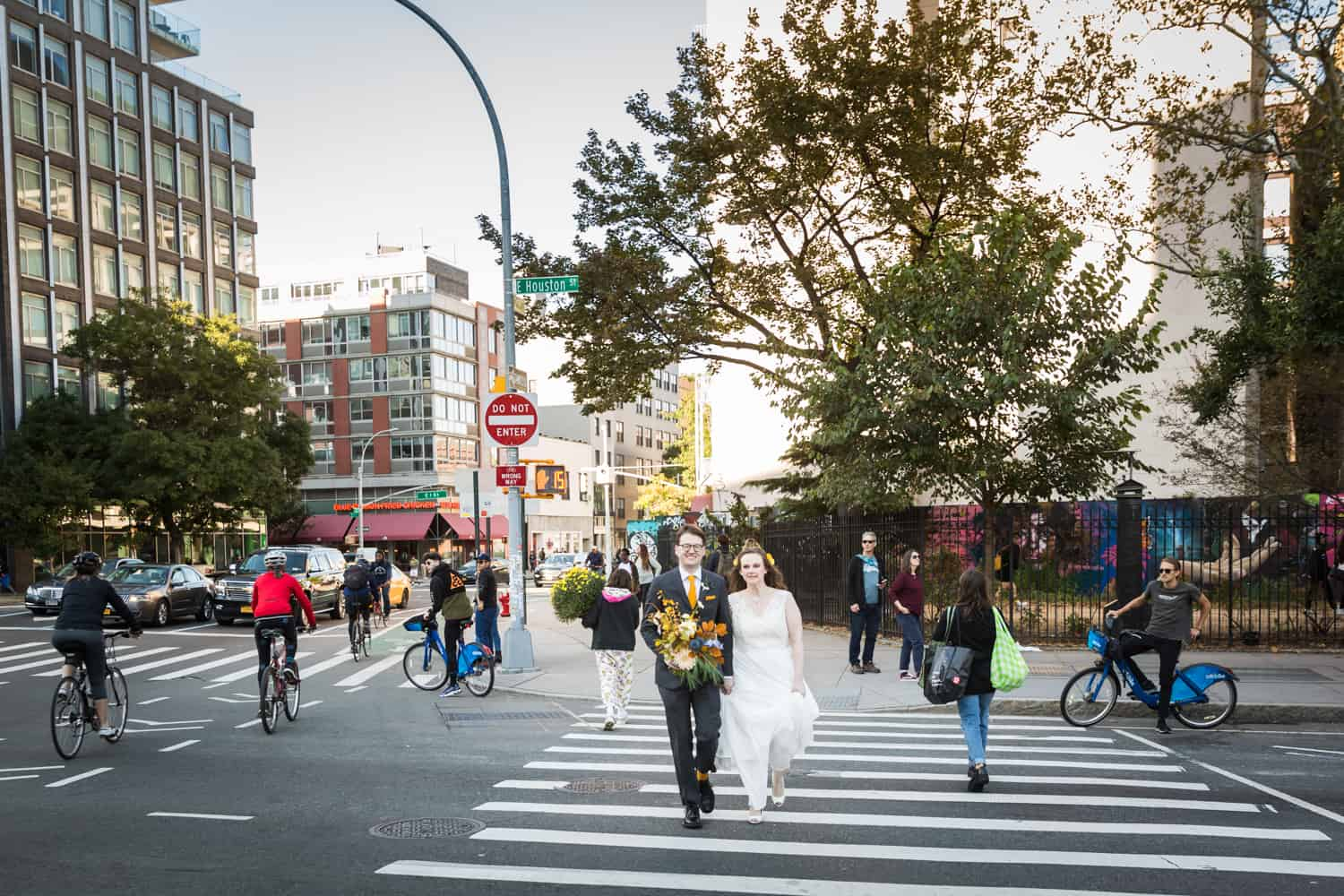 Bride and groom walking in crosswalk for an article on Covid-19 wedding planning