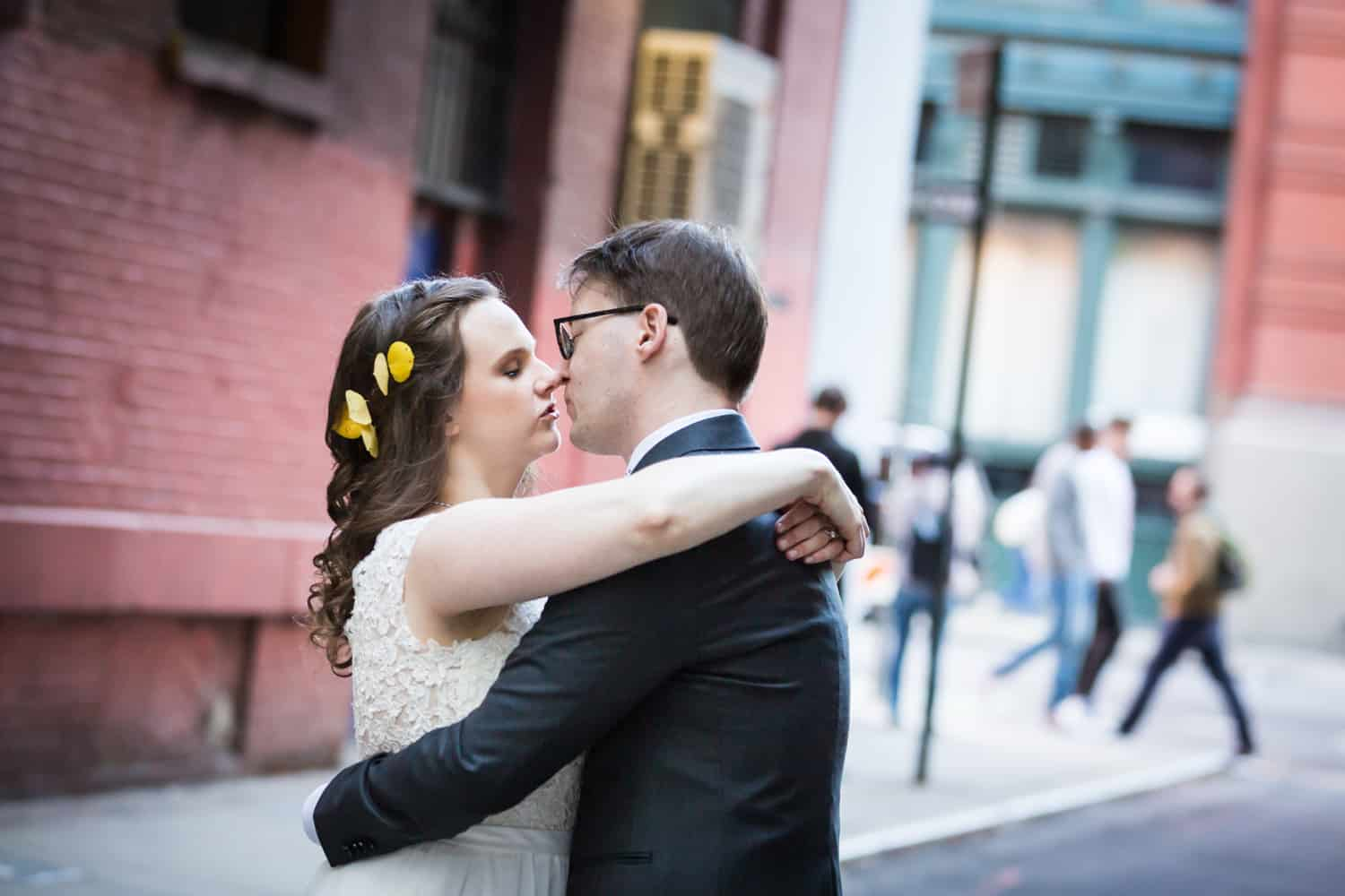Bride and groom about to kiss in alleyway for an article on Covid-19 wedding planning