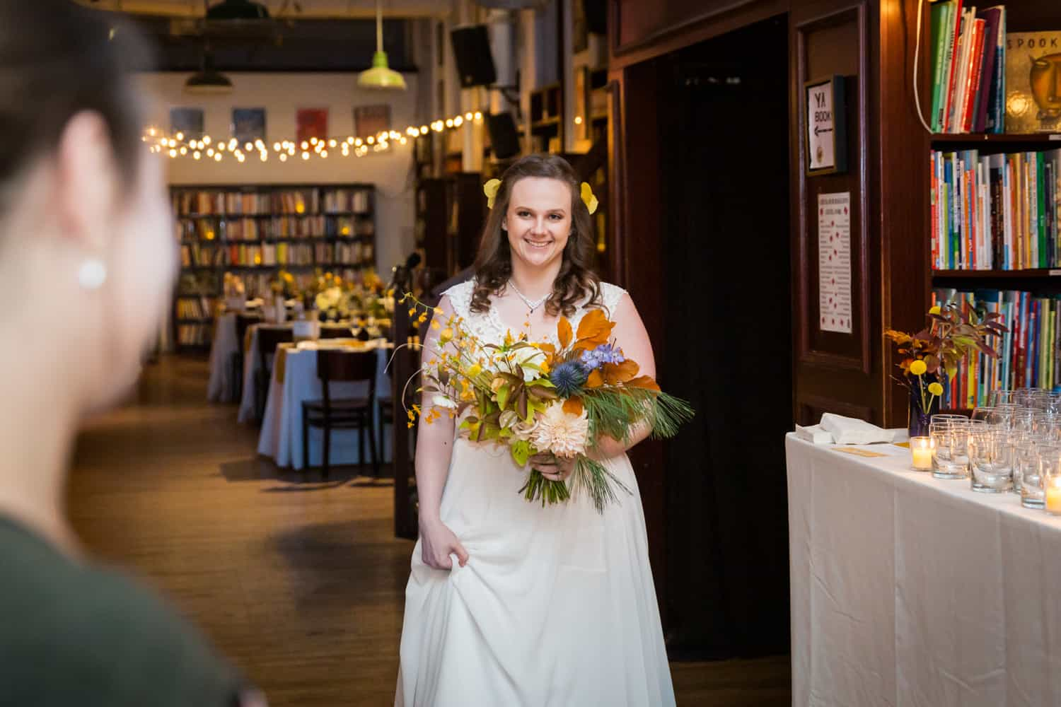 Bride holding bouquet and walking down aisle for an article on Covid-19 wedding planning