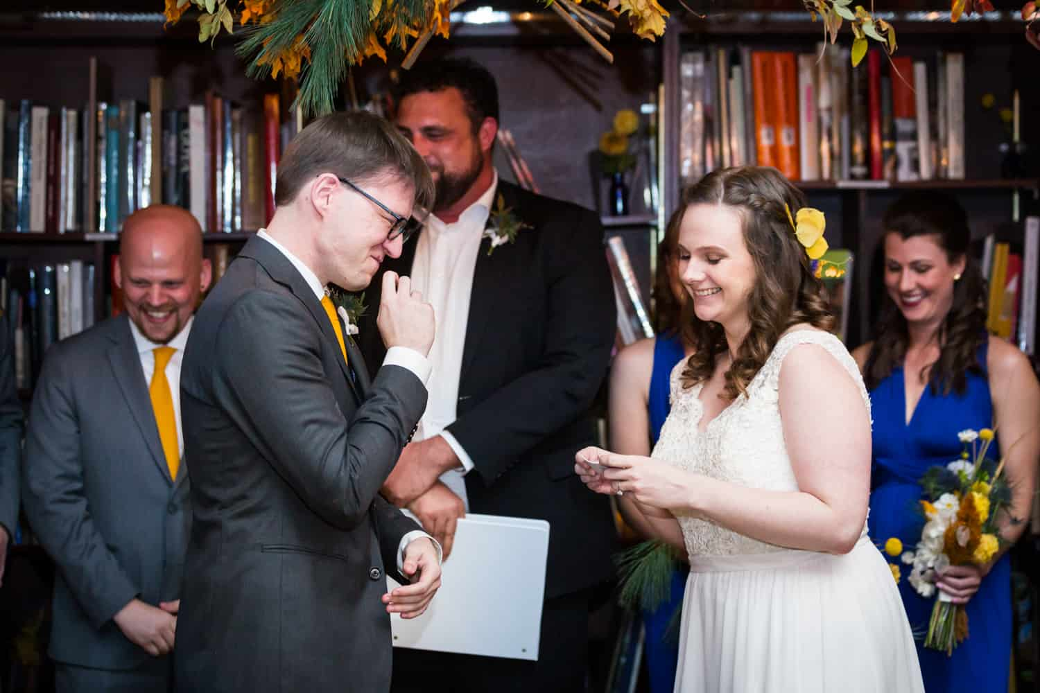 Bride and groom laughing during ceremony for an article on Covid-19 wedding planning