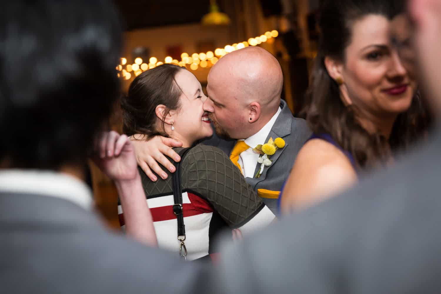 Couple kissing during reception