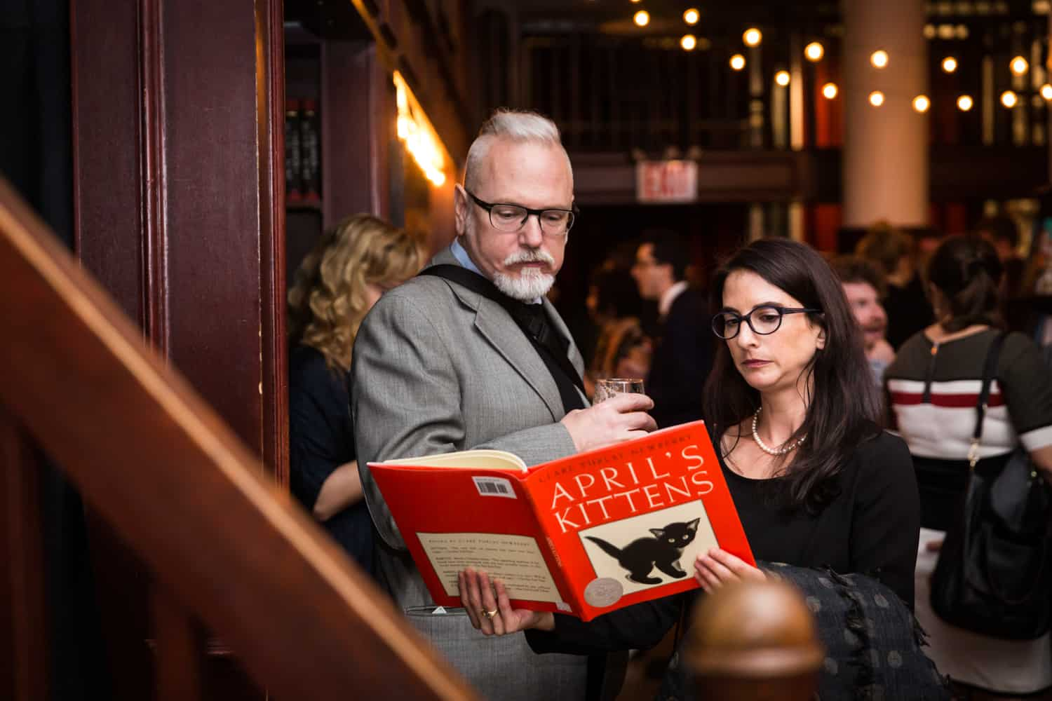 Guests reading from a book at a Housing Works Bookstore Cafe wedding