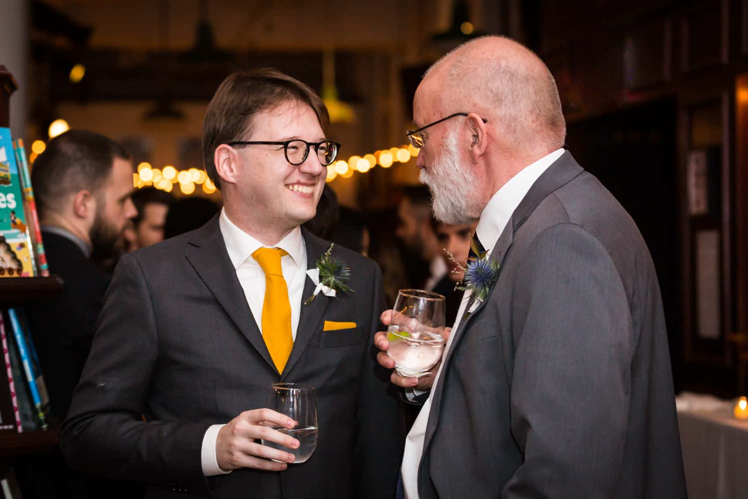 Groom smiling with father at a Housing Works Bookstore Cafe wedding