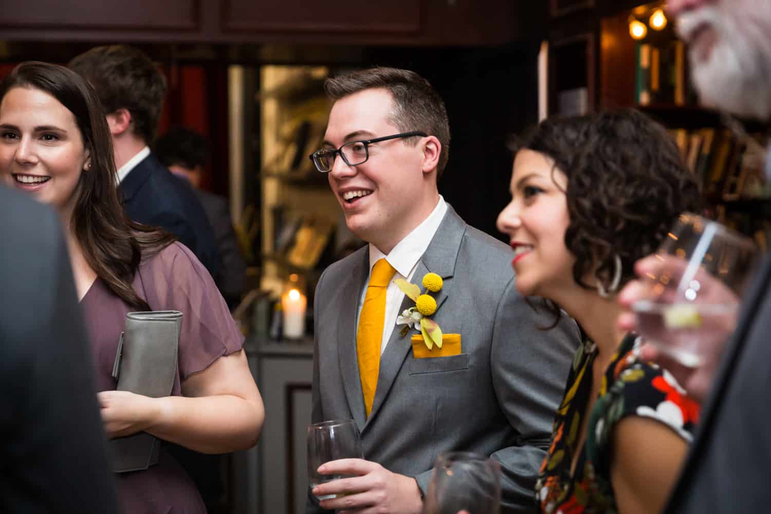 Guests enjoying reception at a Housing Works Bookstore Cafe wedding
