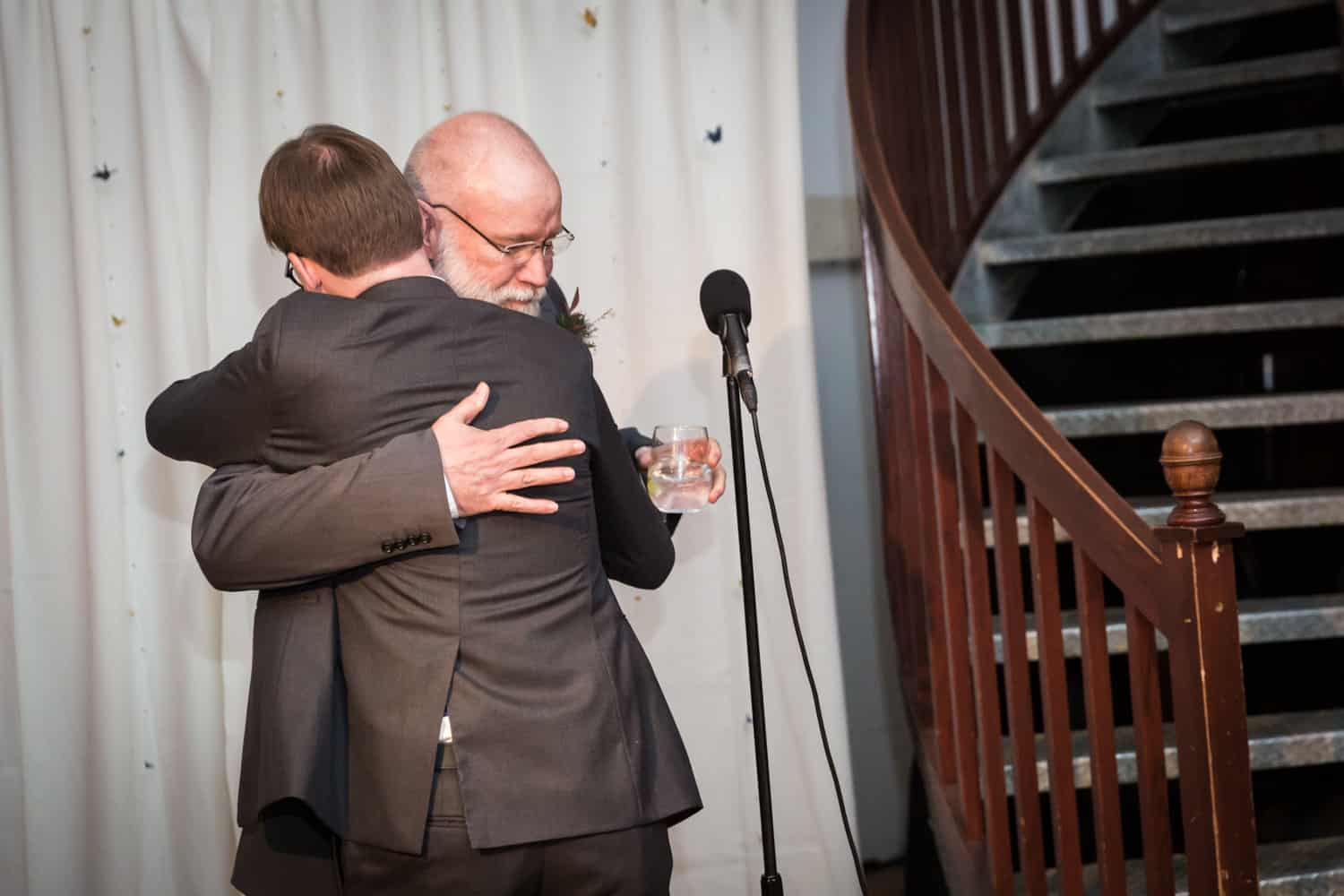 Father hugging groom after toast at a Housing Works Bookstore Cafe wedding