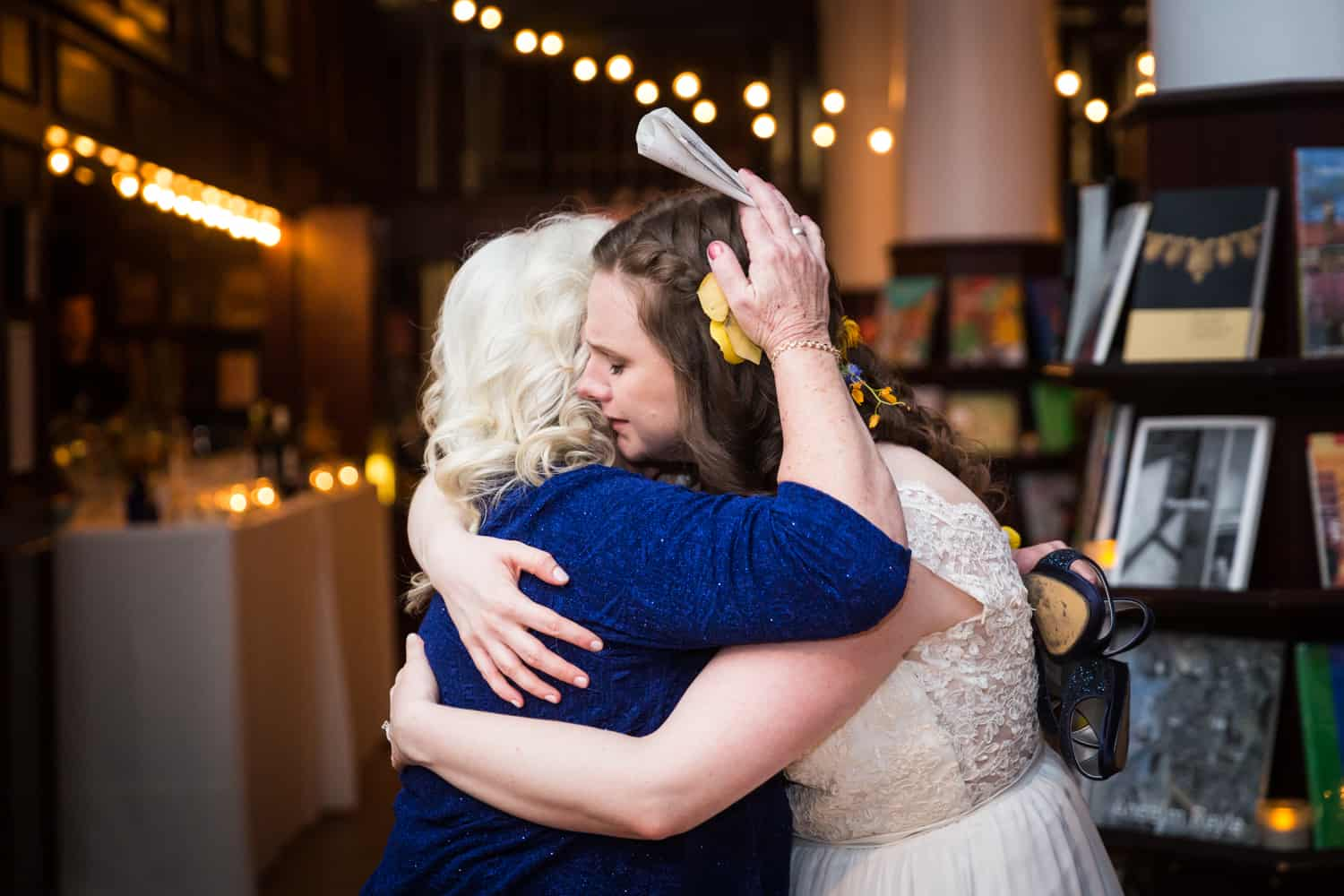 Bride hugging mother at a Housing Works Bookstore Cafe wedding