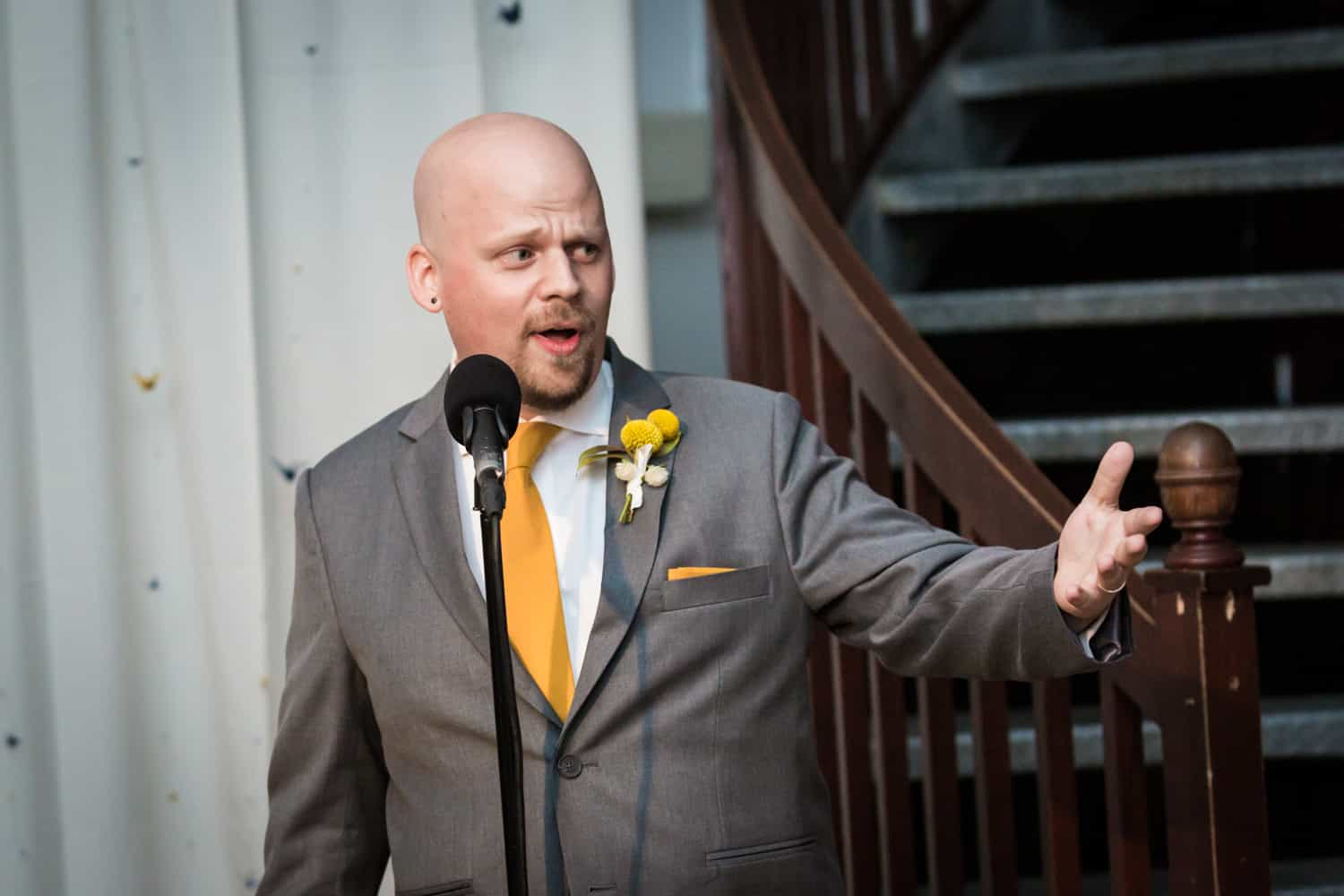 Best man gesturing during speech at a Housing Works Bookstore Cafe wedding