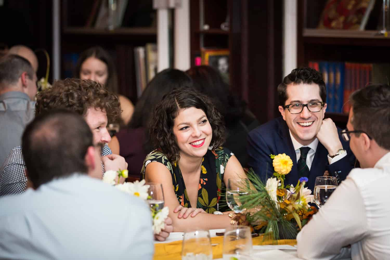 Guests laughing during reception at a Housing Works Bookstore Cafe wedding