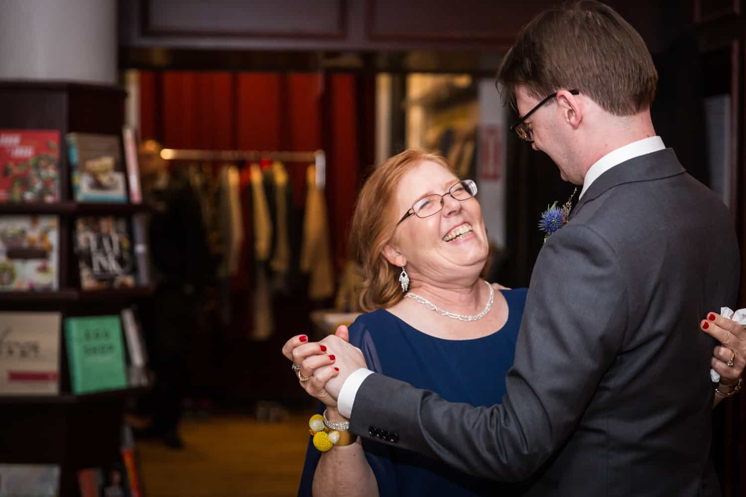 Groom dancing with mother at a Housing Works Bookstore Cafe wedding