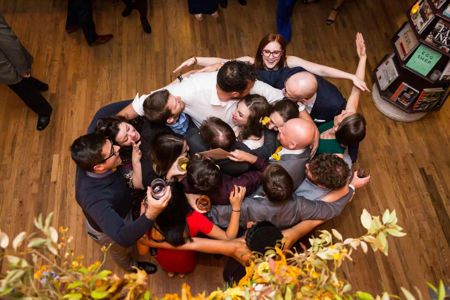 Guests dancing in tight circle at a Housing Works Bookstore Cafe wedding