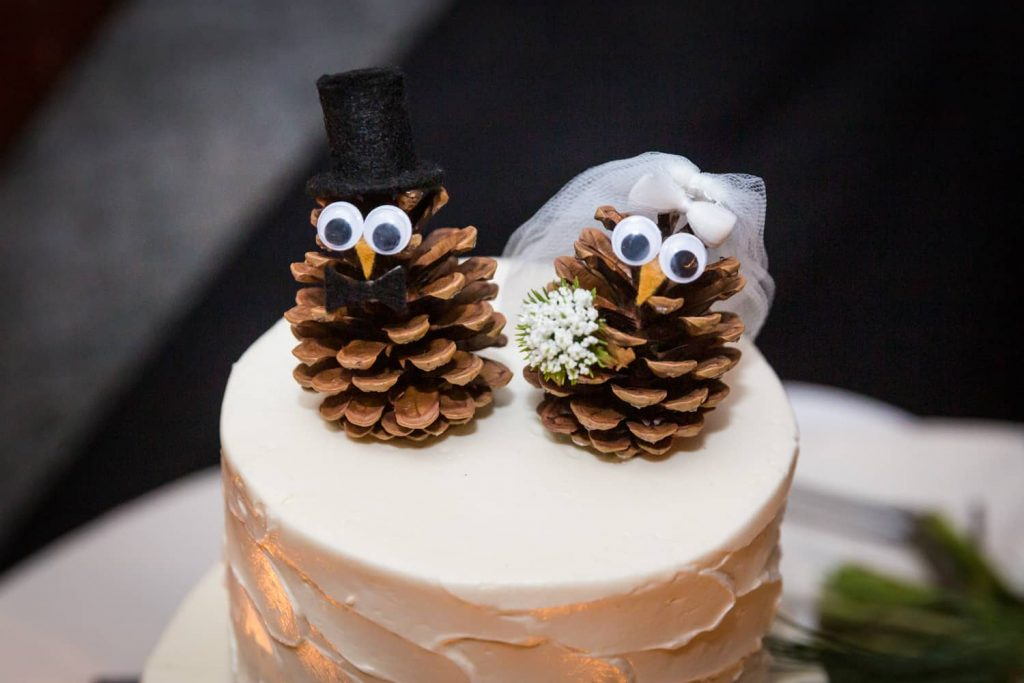 Wedding cake topper made of pine cones