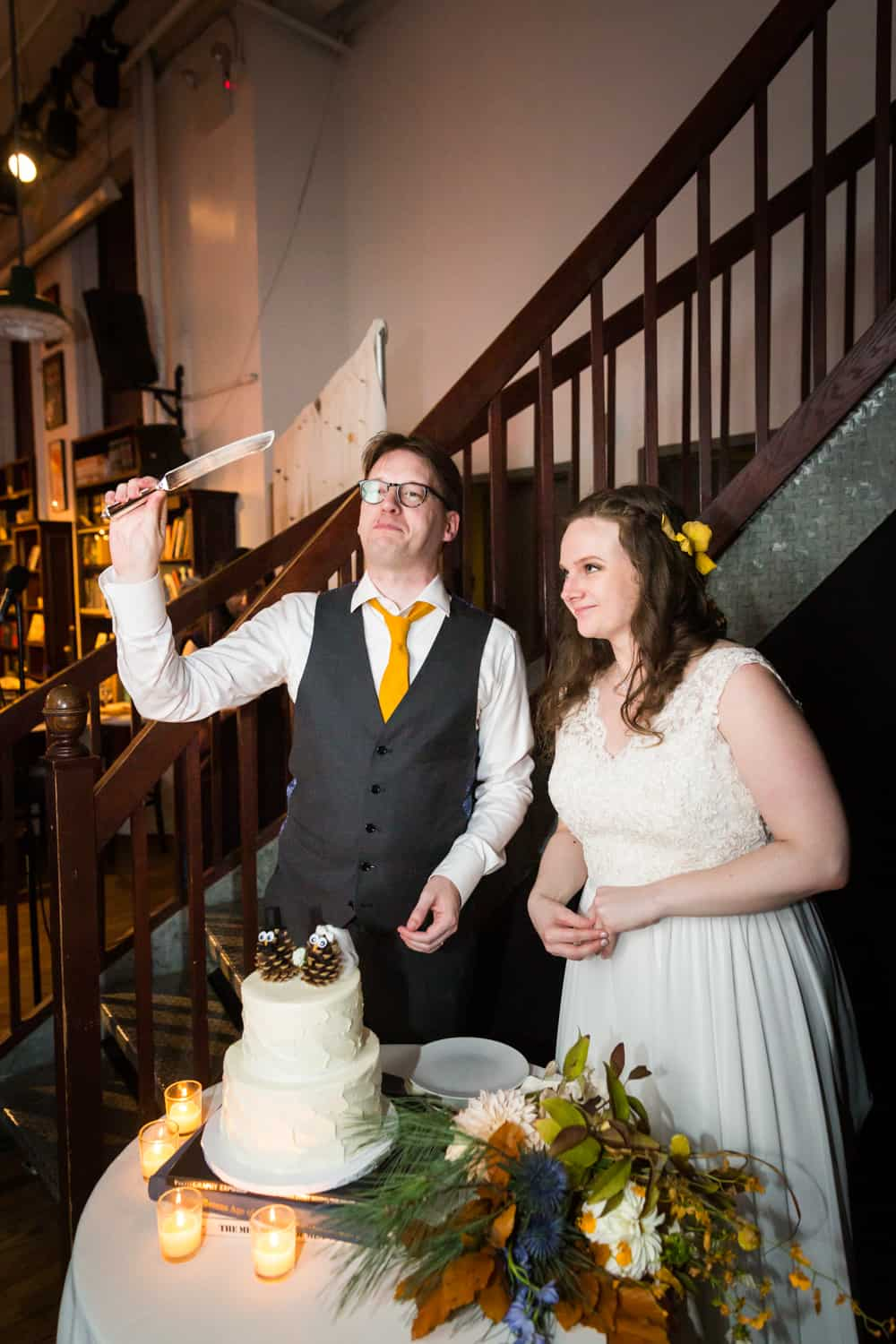 Bride and groom about to cut cake at a Housing Works Bookstore Cafe wedding