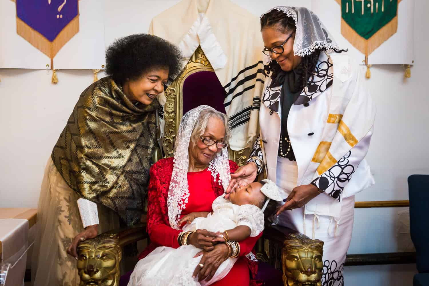Grandmother holding baby surrounded by two older female family members