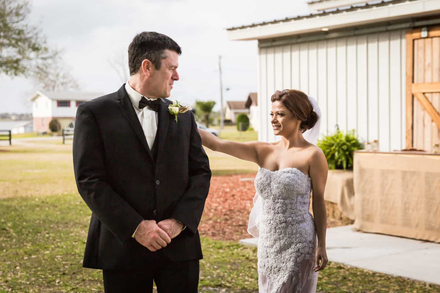 Groom seeing bride for first time at first look for an article on wedding cost cutting tips