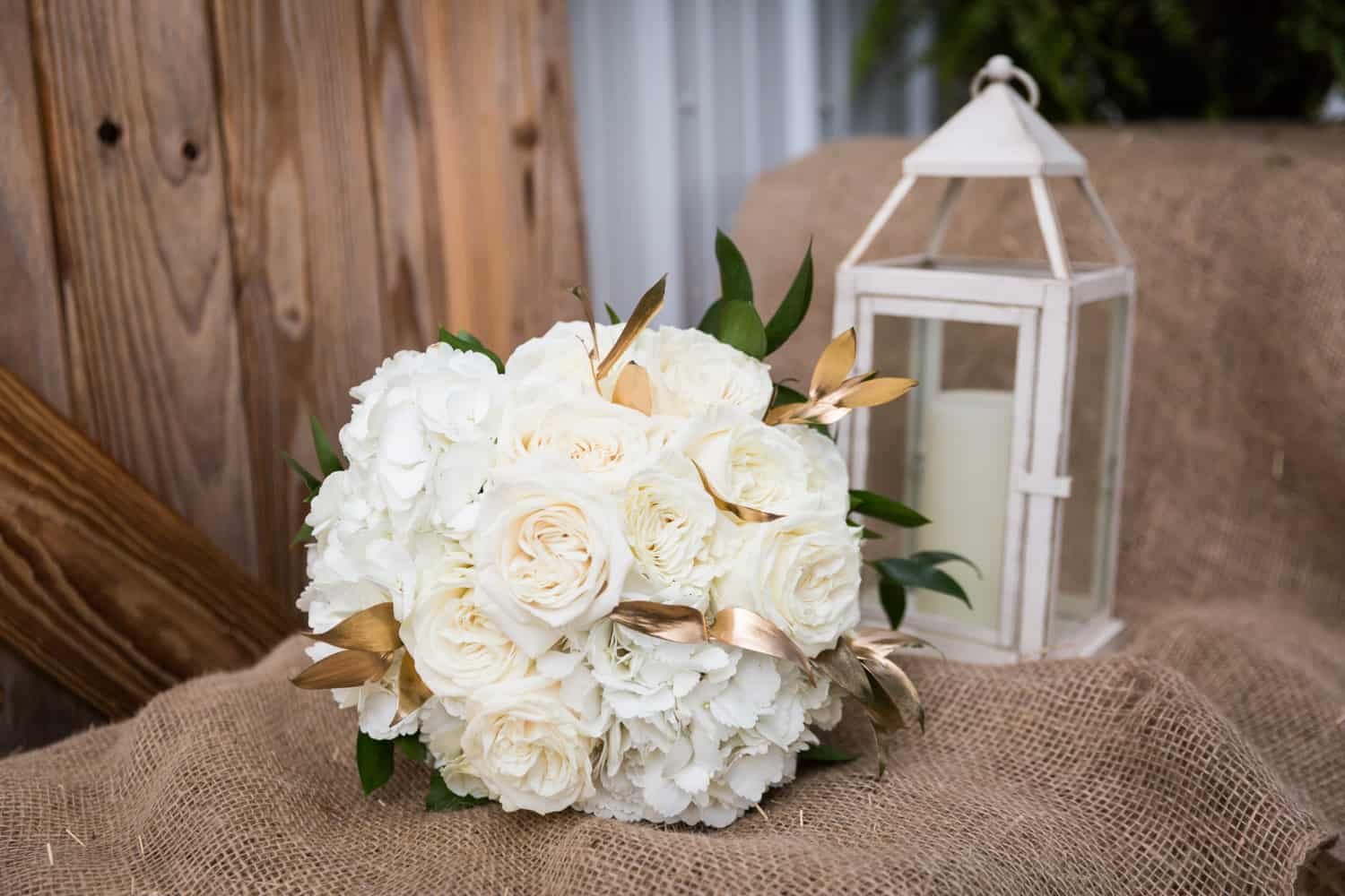 Bridal bouquet of white roses for an article on wedding cost cutting tips
