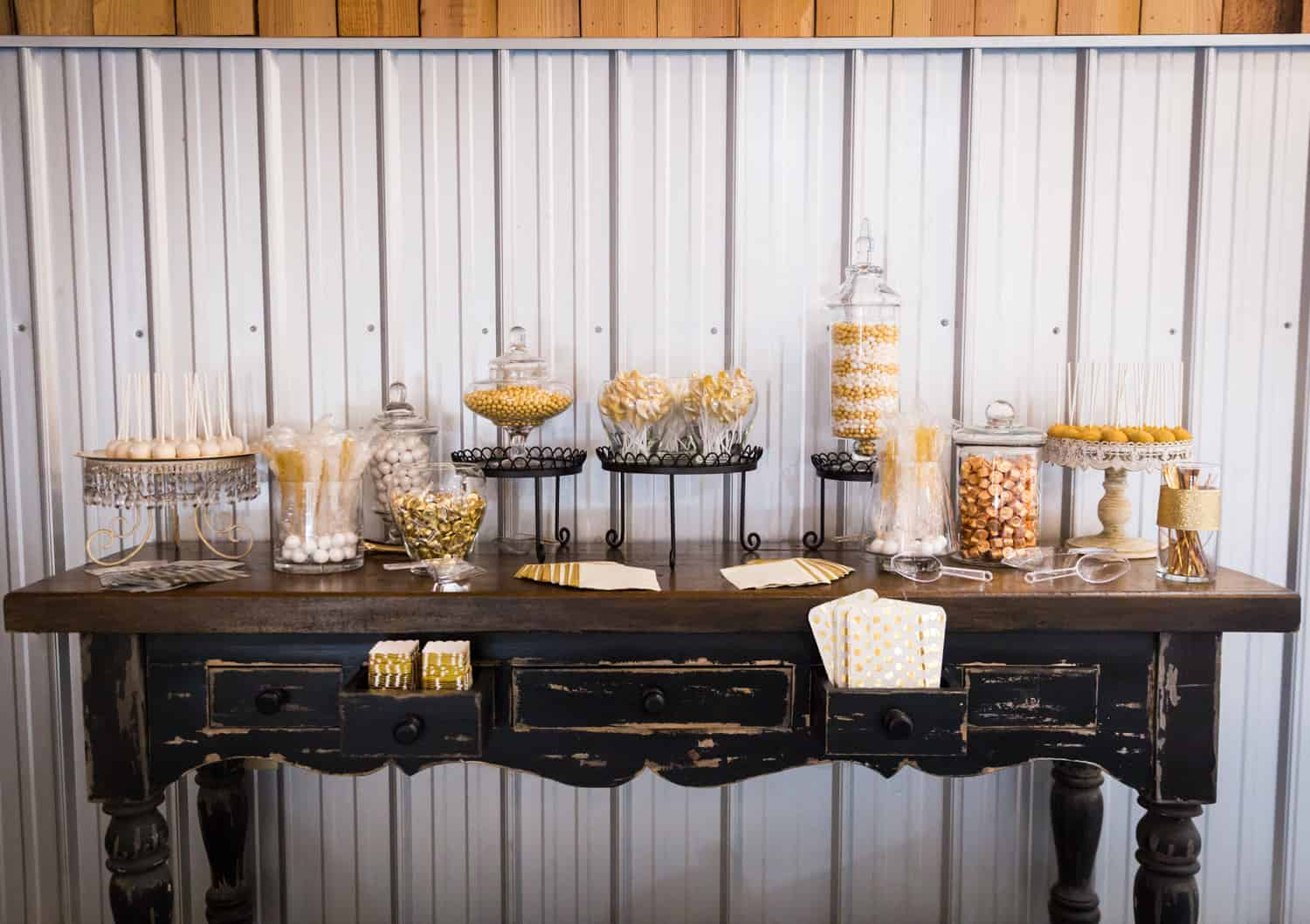 Candy buffet with gold-colored candies on table