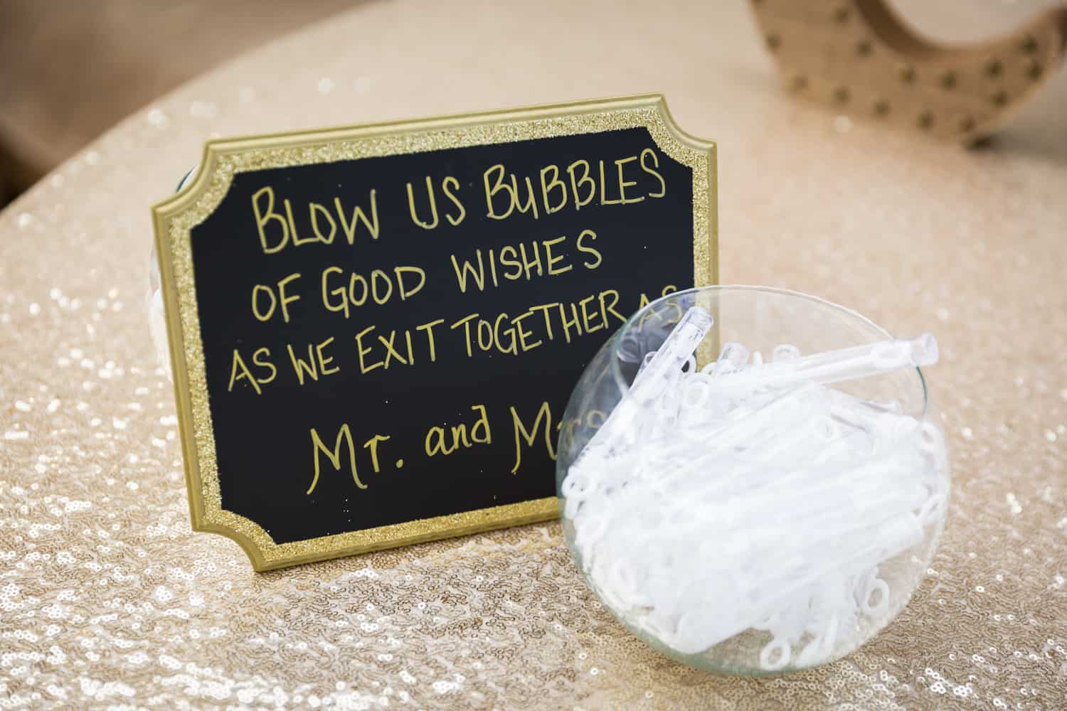 Bowl of bubbles with sign for guests