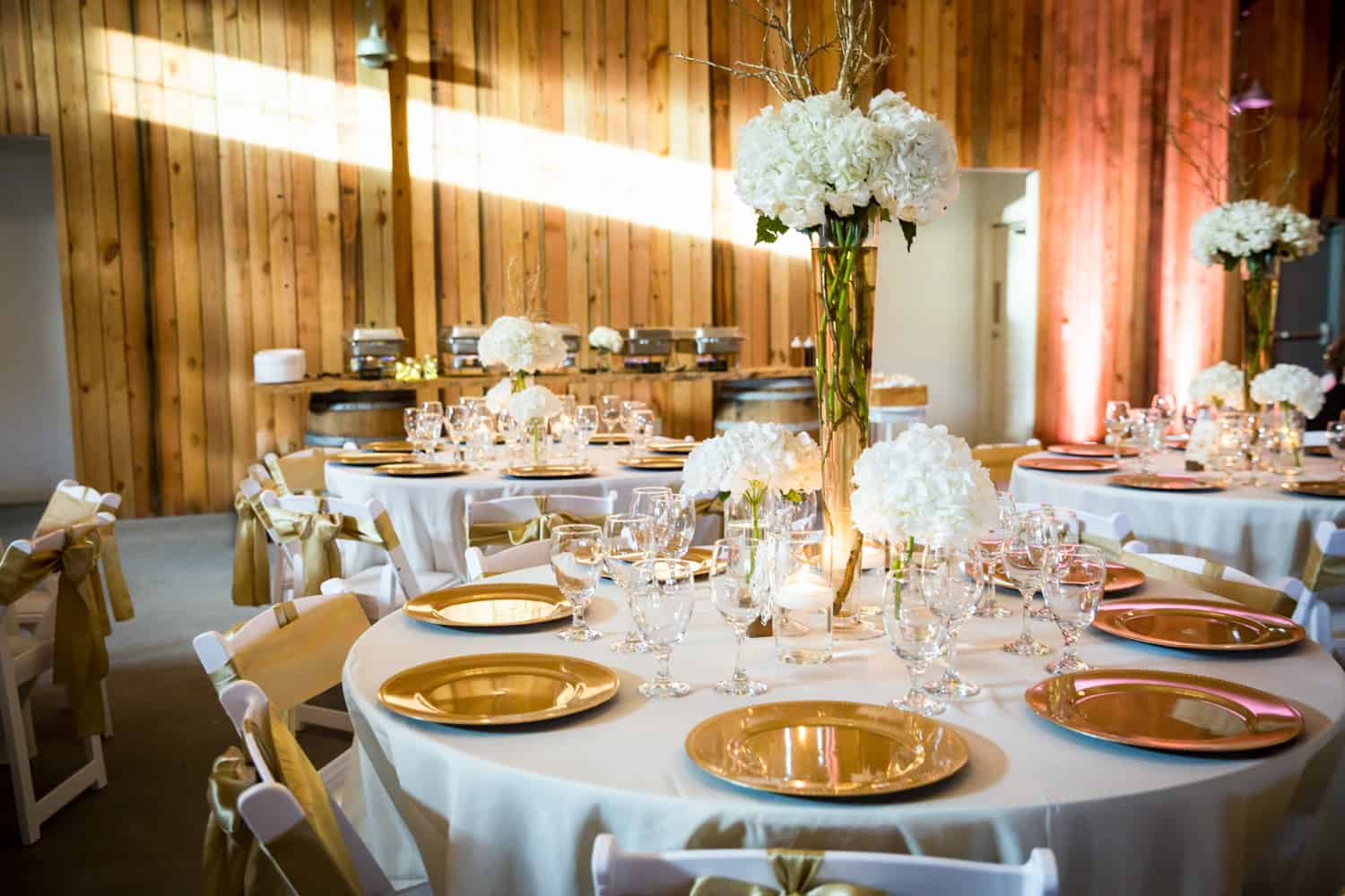 Place setting with gold chargers for an article on wedding cost cutting tips