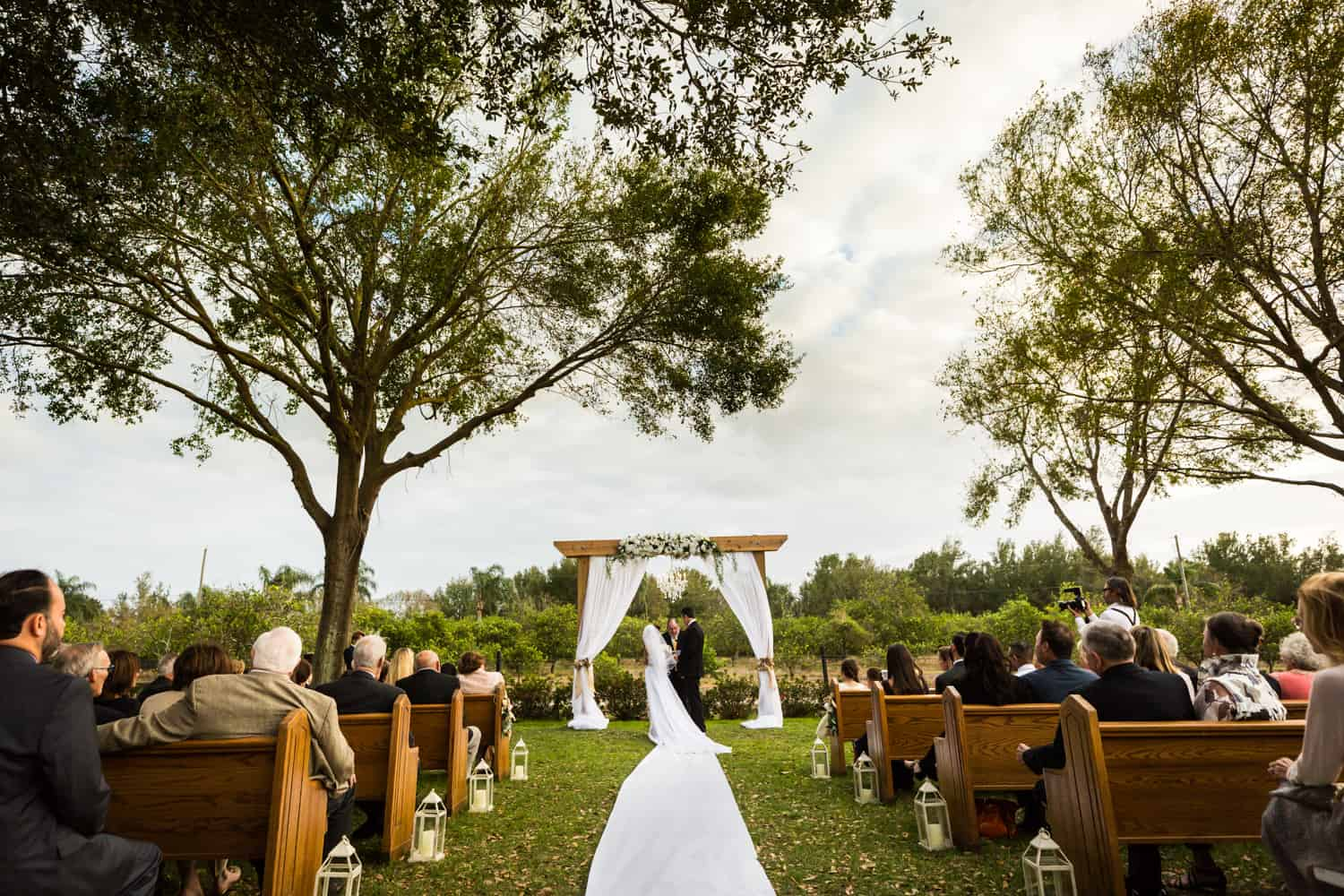 Wide shot of outdoor ceremony for an article on wedding cost cutting tips