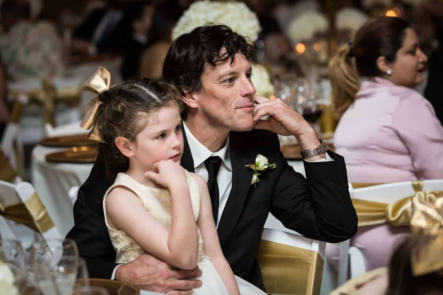 Man and little girl listening to speeches for an article on wedding cost cutting tips