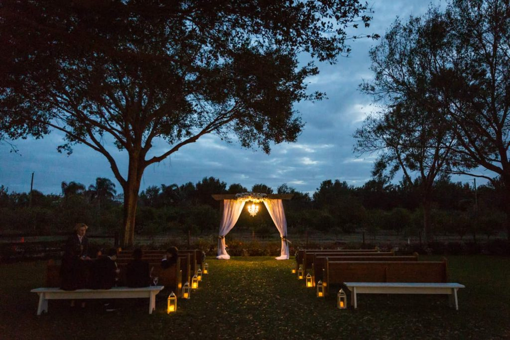 Wedding ceremony altar lit during the evening