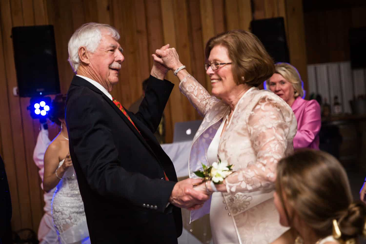 Mother of groom dancing with older man during Florida wedding reception