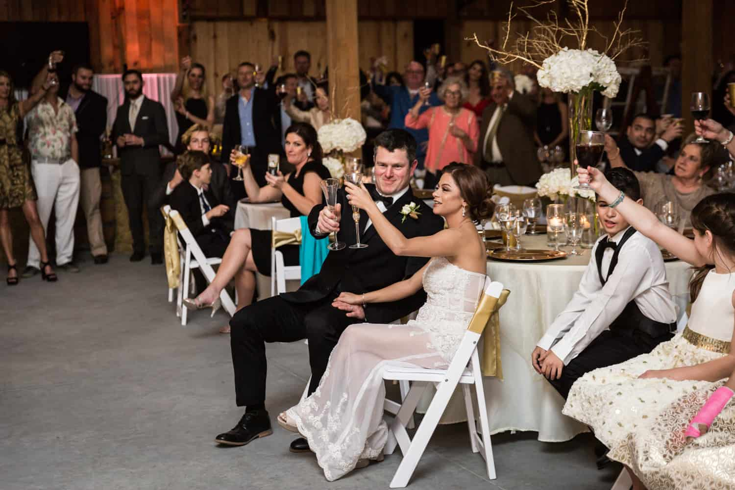 Bride and groom toasting champagne glasses for an article on wedding cost cutting tips