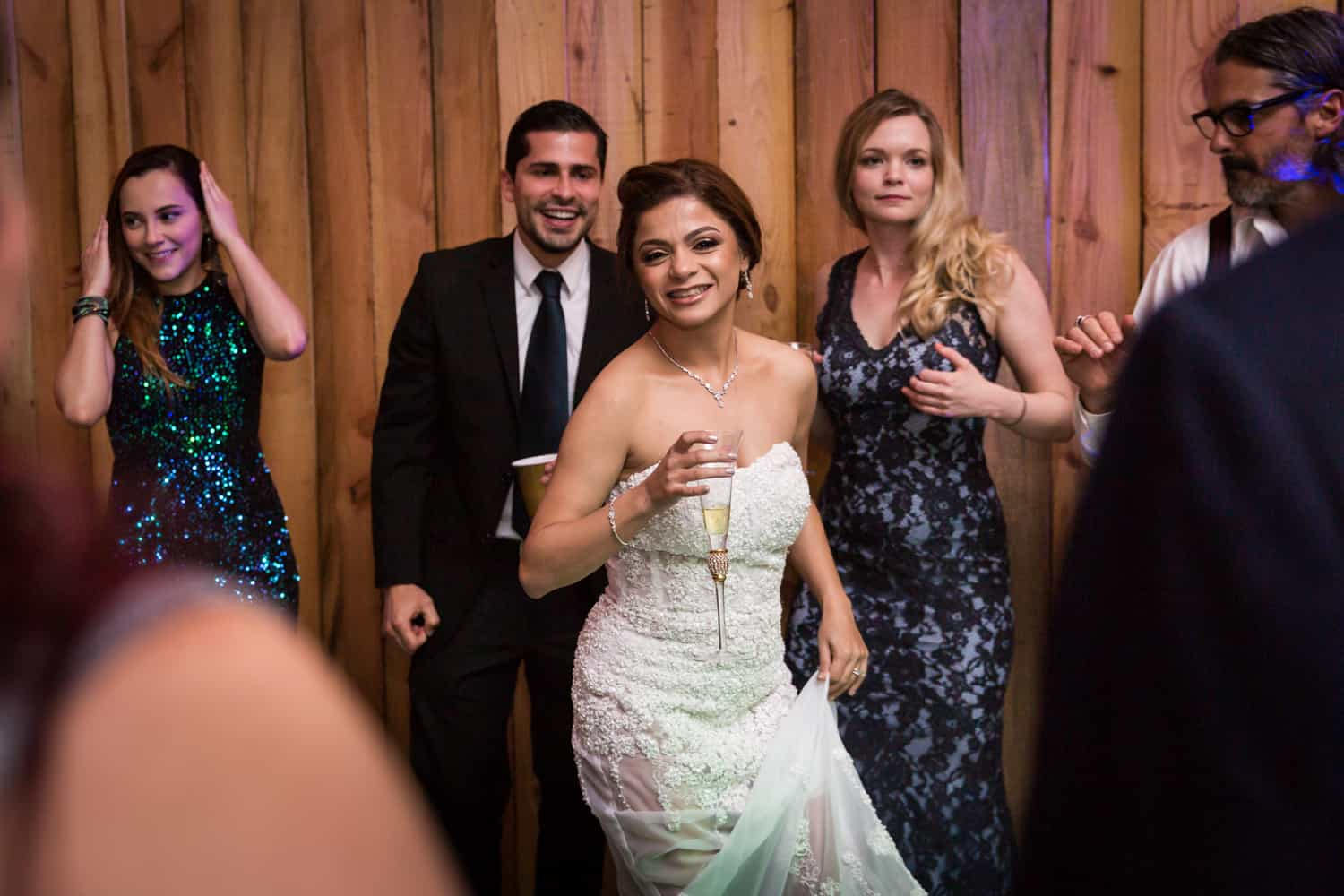 Bride dancing with guests during Florida wedding reception