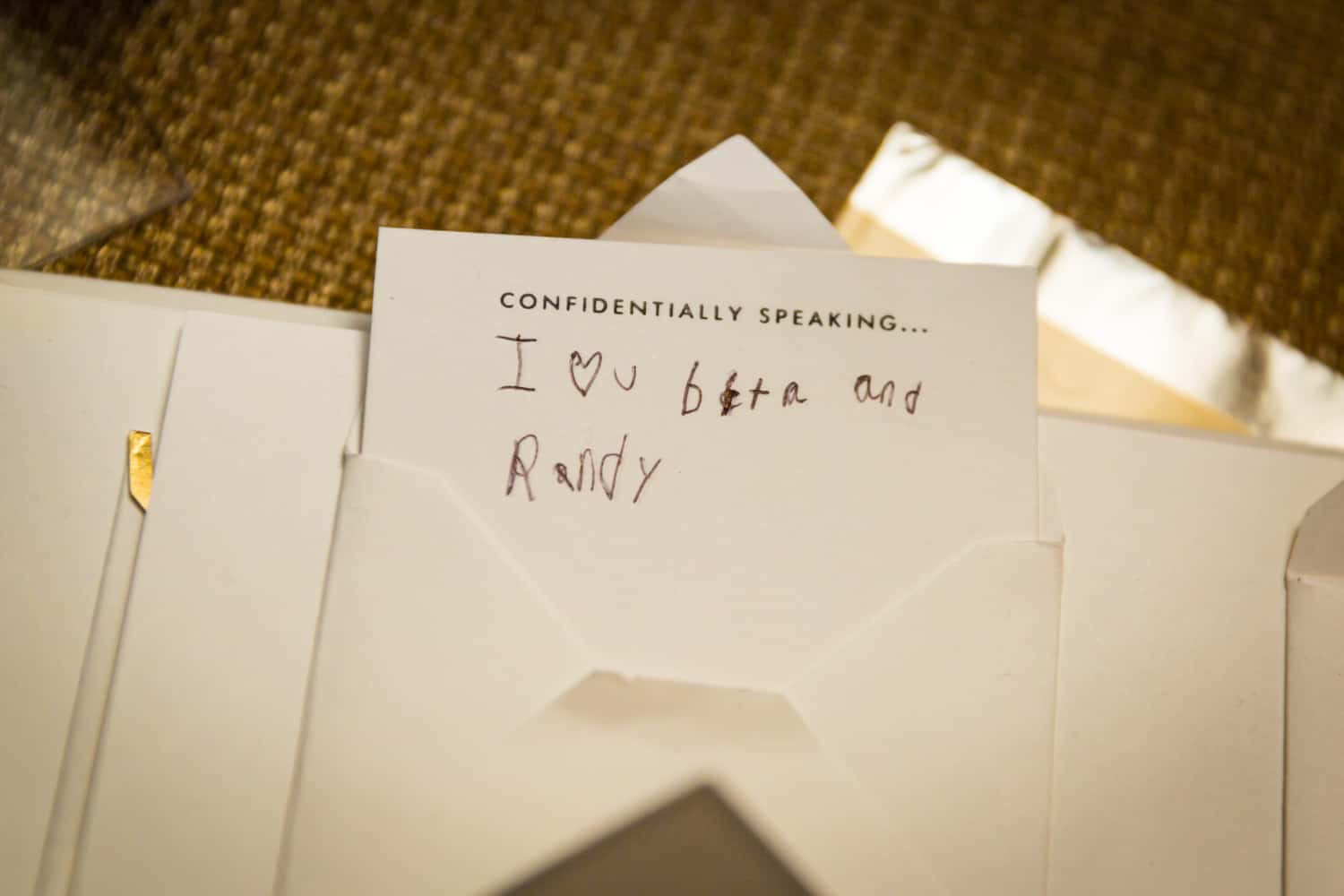 Envelope containing note for bride and groom