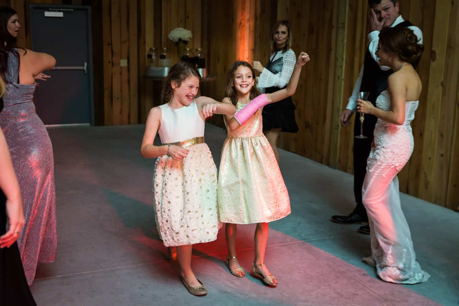 Two little girls dancing during Florida wedding reception