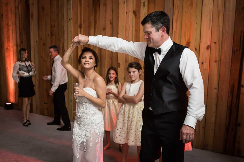 Broom twirling bride on dance floor