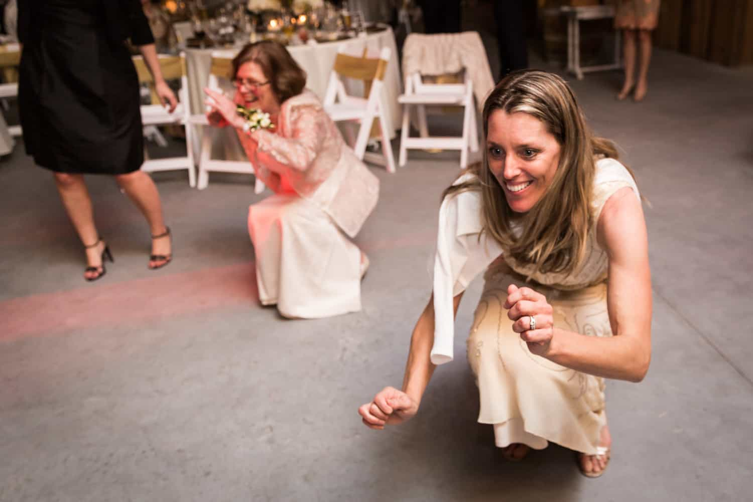 Two female guests dancing close to floor