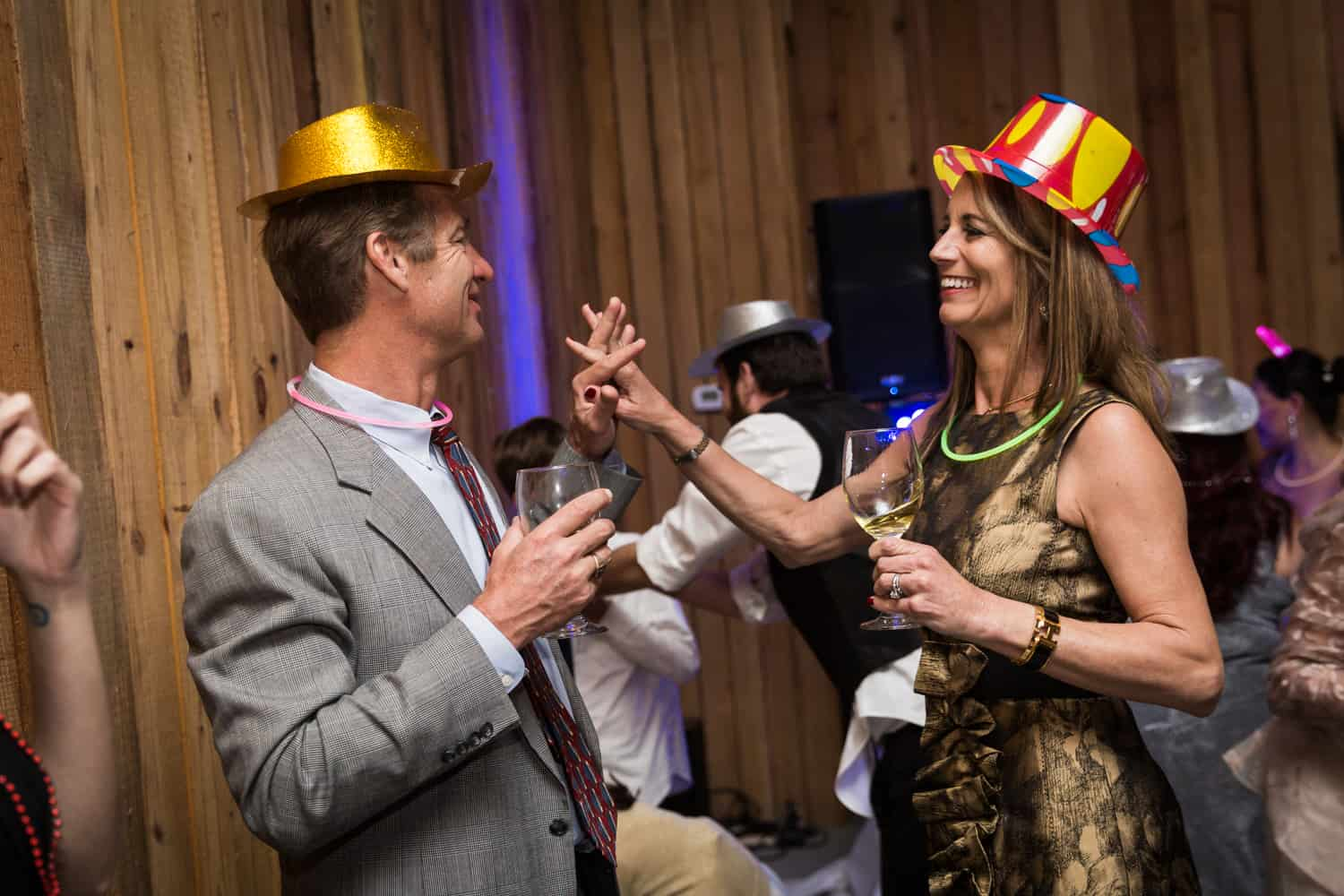 Couple wearing party hats and dancing during Florida wedding reception