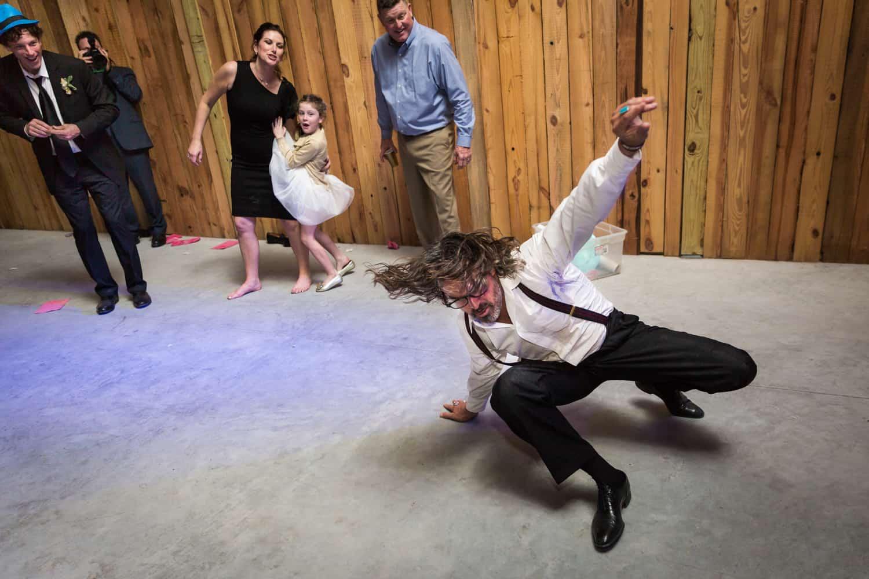 Guests watching man dance on floor