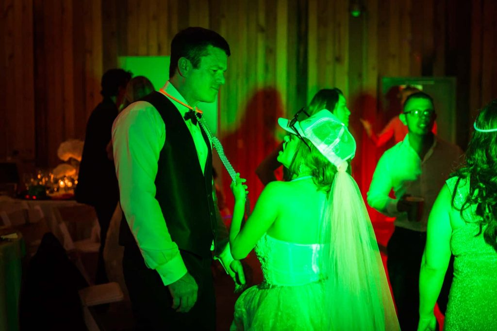 Bride and groom in green light dancing
